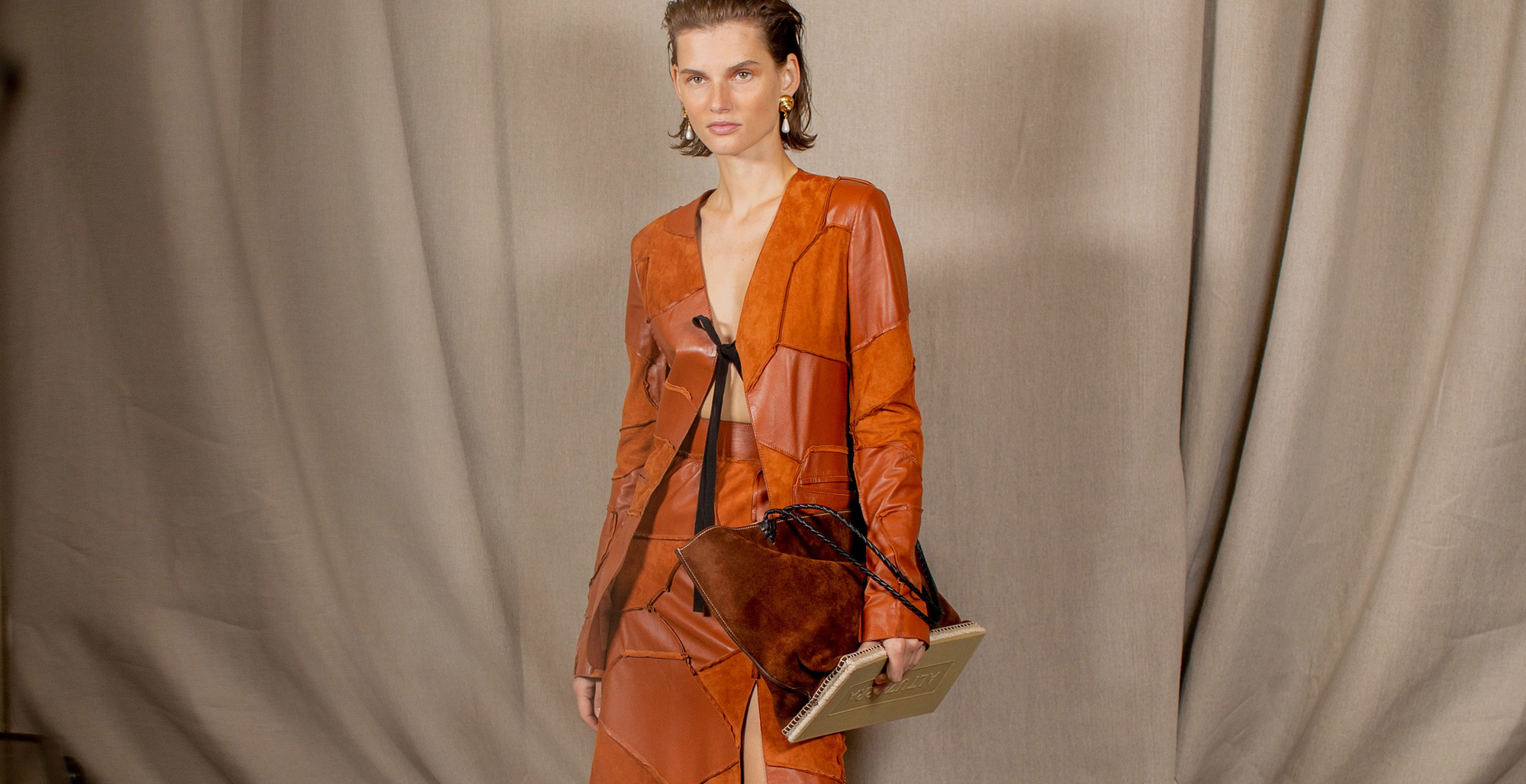 The Altuzarra Woman - model in leather dress holding espadrille bag