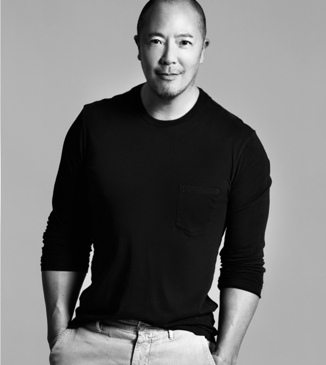 Derek Lam leaning against a wall