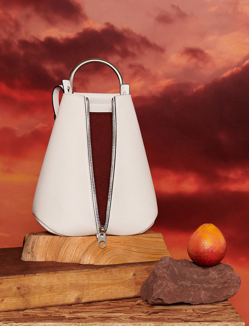 Discover the Vertical Zip Backpack and new fall handbags.